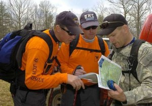 Chris McCracken and Allen Ramsey checking maps during a search. Maps and GPS are frequently used during training